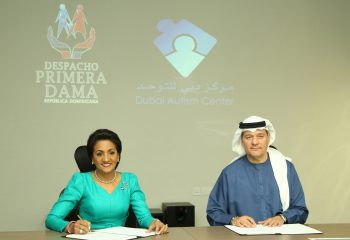 Dominican First Lady and Mr Emadi signing the MoU